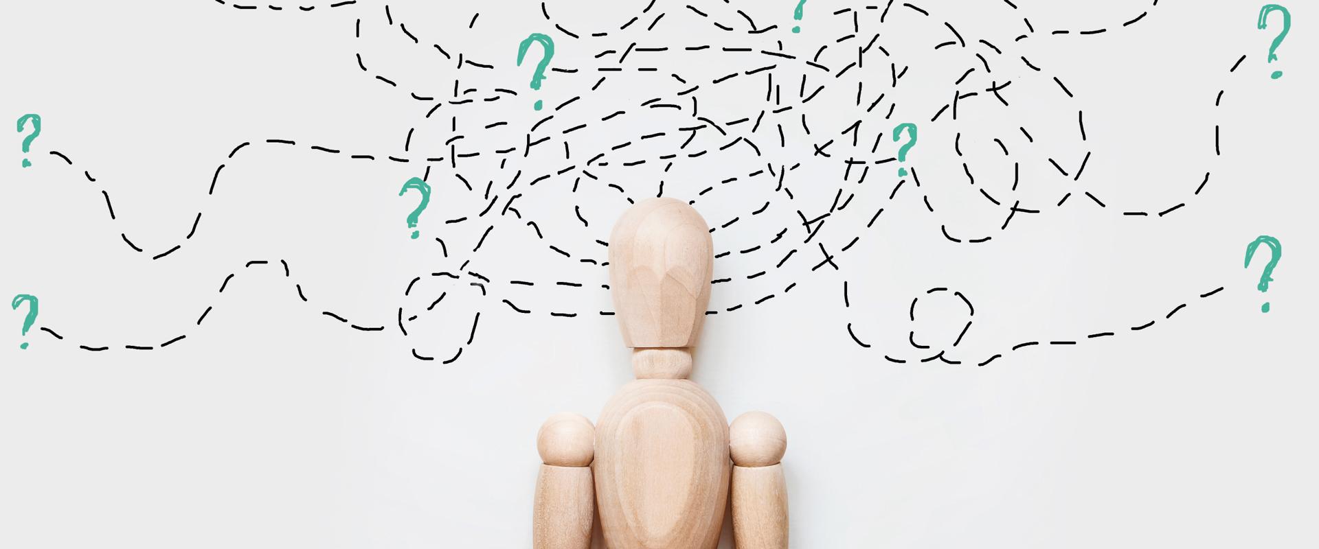 Grafische Darstellung mit Fragezeichen um den Kopf